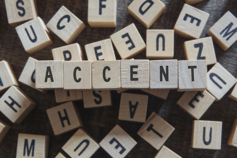 Wooden cubes spelling out the word ACCENT